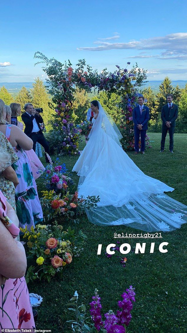 45070305-9758451-Here_comes_the_bride_Ellie_dazzled_in_an_exquisite_white_gown_wi-a-10_1625602696342.jpg
