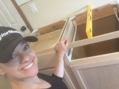 Mary building cabinets.JPG