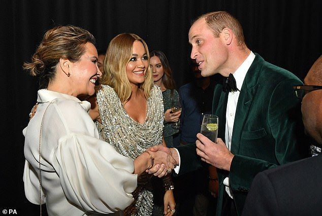 20973594-7682021-Prince_William_met_singer_Rita_Ora_middle_and_other_guests_as_he-a-35_1573680821864.jpg