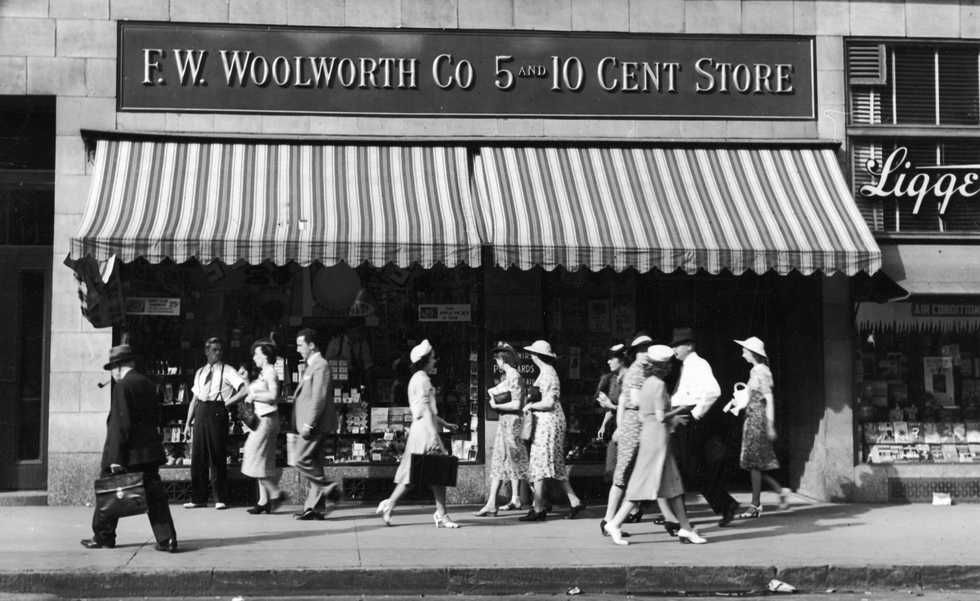 people-walk-past-an-f-w-woolworth-five-and-dime-store-on-a-news-photo-1761142-1542316091.jpg