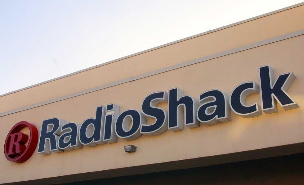 radio-shack-sign-hangs-above-its-storefront-january-3-2002-news-photo-689689-1542311299.jpg