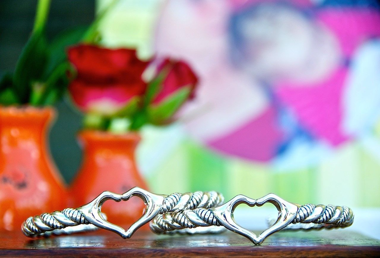 Love collection. 2 Love cuffs in front of picture of mom and Olive 4.6 launch.jpg